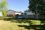 Large private partially fenced backyard with large shade trees - great for kids